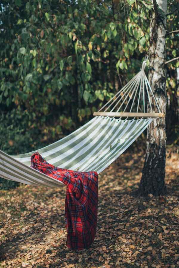 red and black plaid blanket on hammock